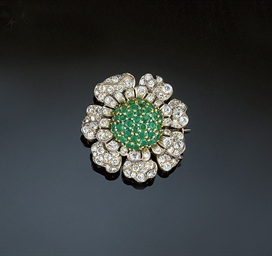 A diamond and emerald brooch