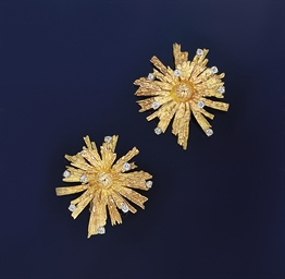 A pair of diamond set earclips