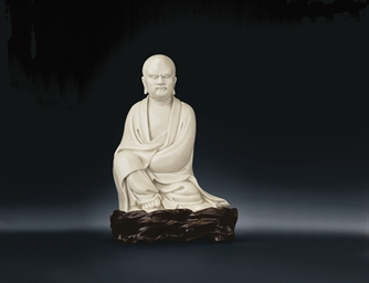 A DEHUA SEATED FIGURE OF DAMO