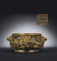 A PARCEL-GILT BRONZE 'DRAGON'