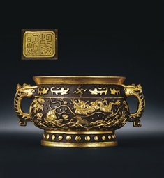 A PARCEL-GILT BRONZE CENSER