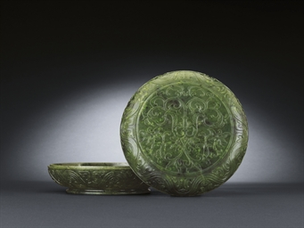 A SPINACH JADE CIRCULAR BOX AN