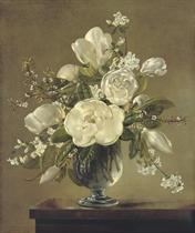 White blossom and magnolia in a glass vase