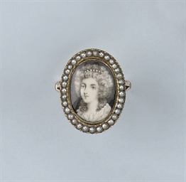 AN ANTIQUE MINIATURE RING