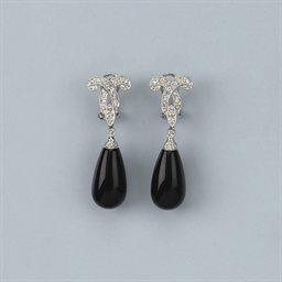 A PAIR OF ONYX AND DIAMOND EAR