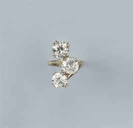 A DIAMOND THREE STONE RING, BY