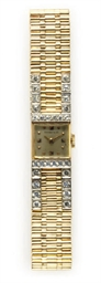 A DIAMOND AND GOLD WATCH, BY T