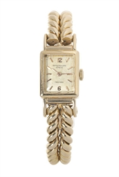 AN 18K GOLD BRACELET-WATCH, BY
