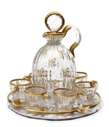 A FRENCH GLASS CORDIAL SET,