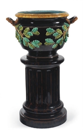 A FRENCH MAJOLICA JARDINERE AN