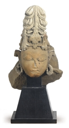 A SANDSTONE HEAD FRAGMENT OF S