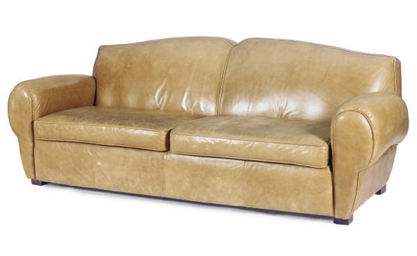 A LEATHER-UPHOLSTERED SOFA,
