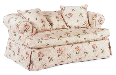 A PINK FLORAL COTTON UPHOLSTER