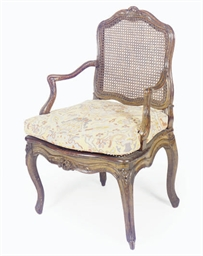 A LOUIS XV WALNUT AND CANED FA
