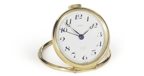 A BRASS DESK CLOCK,