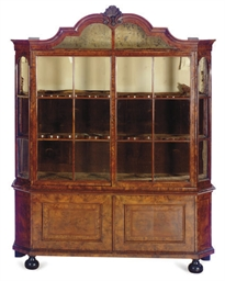 A DUTCH WALNUT BOOKCASE-CABINE