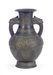 A JAPANESE BRONZE TWIN-HANDLED