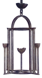 A FRENCH WROUGHT IRON FOUR-LIG