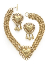 A CHRISTIAN LACROIX GILT-METAL TRIPLE-CHAIN HEART NECKLACE WITH MATCHING EAR-CLIPS,