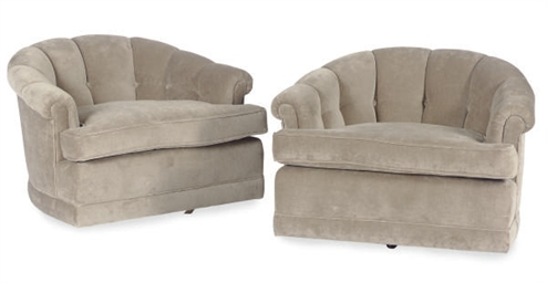 A PAIR OF UPHOLSTERED SWIVEL L
