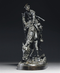 A bronze figure of a Cossack o
