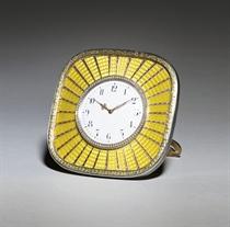 A silver-gilt and gold-mounted guilloché enamel sunburst clock