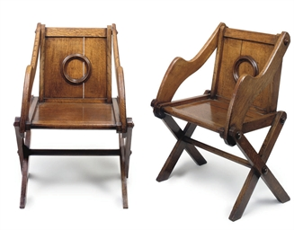 A PAIR OF VICTORIAN OAK GLASTO