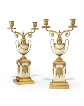 A PAIR OF GEORGE III ORMOLU AND WHITE MARBLE TWO-LIGHT CANDELABRA