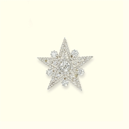 AN ANTIQUE DIAMOND STAR BROOCH
