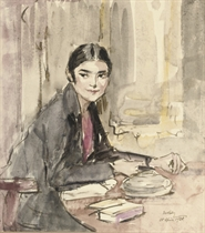 A girl writing at a table