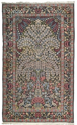 A fine Kirman large prayer rug