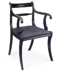 A REGENCY EBONISED AND BRASS I