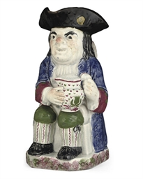 A PEARLWARE TOBY-JUG