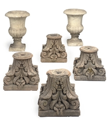 A SET OF FOUR TERRACOTTA CAPIT