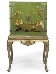 A JAPANNED CABINET ON STAND