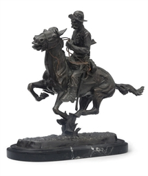 A BRONZE OF A COWBOY ON HORSEB