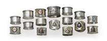 A group of silver and enamel napkin rings for various ships