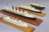 A group of four miniature Ocean Liner models