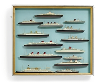 A collection of miniature waterline ocean liner models