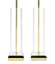 A pair of tall lucite table lamps from the SS Monterey