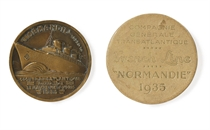 A bronze maiden voyage medallion from the S.S. Normandie