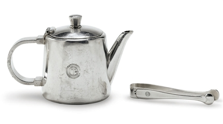 A tea pot and sugar tongs in p
