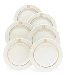 A set of six bread plates for