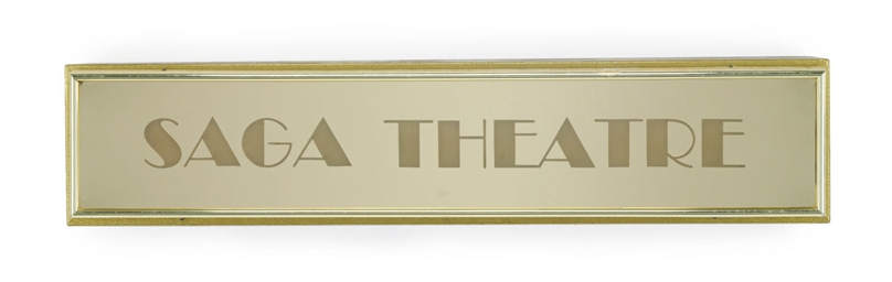 A metal and mirrored sign for