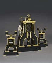 A French brass, patinated brass and marmo nero Belgio striking eight day novelty clock in the form of a steam hammer with moving hammer and twin-light candelabra