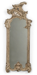 A GERMAN CARVED WOOD MIRROR