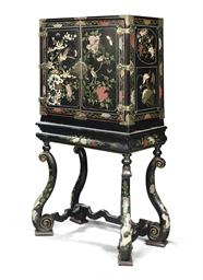 A WILLIAM III COROMANDEL LACQUER AND POLYCHROME-JAPANNED CABINET-ON-STAND