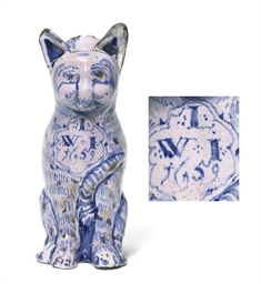 A LONDON DELFT DATED CAT JUG