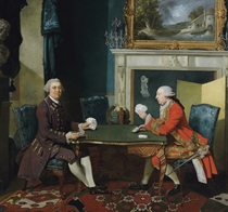 Double portrait of two gentlemen playing cards in an interior