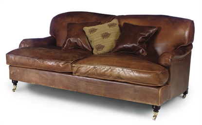 A LEATHER UPHOLSTERD SOFA